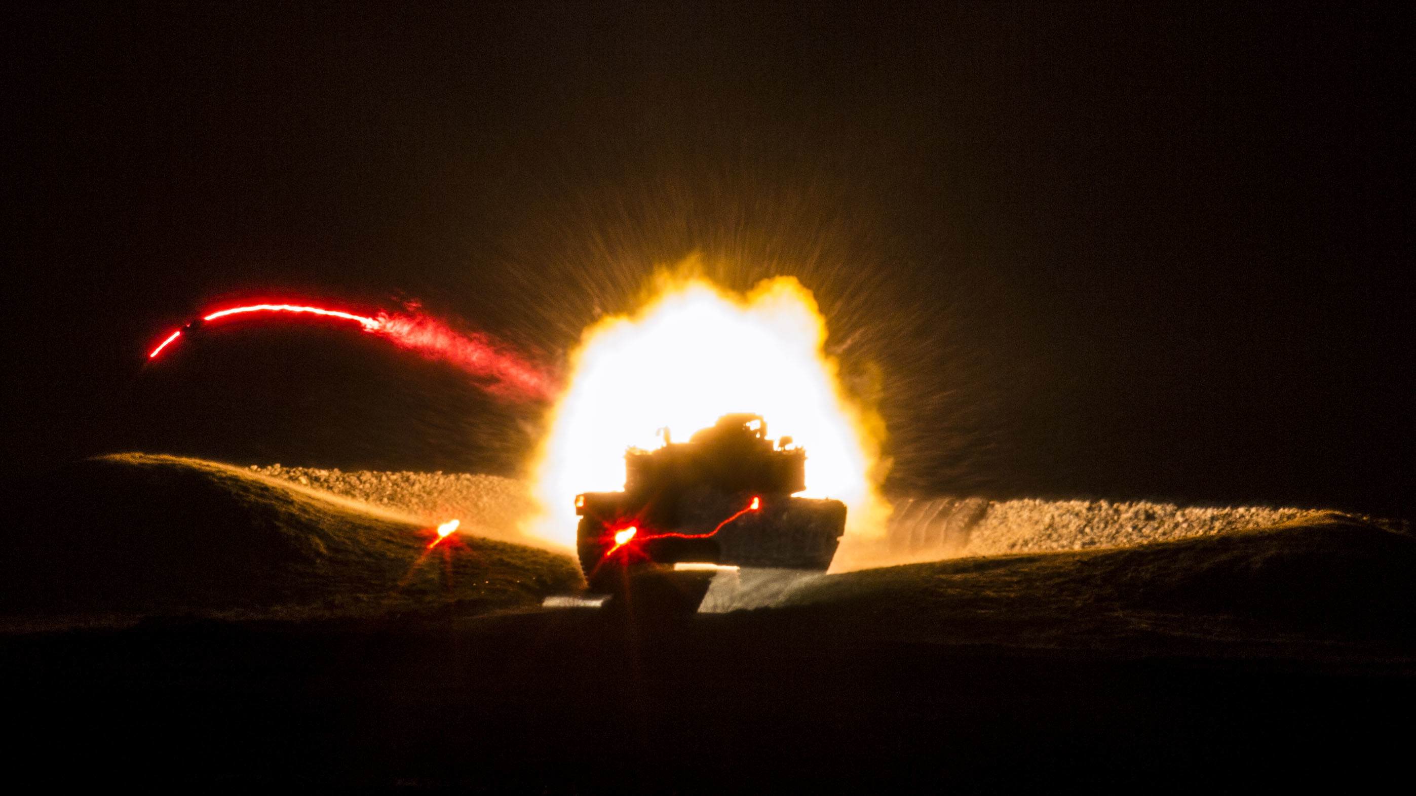 U.S. Marines with Company B, 2nd Tank Battalion, fire a 120mm smoothbore main gun from an M1A1 Abrams Main Battle Tank during a live-fire exercise at Range SR-10, Camp Lejeune, N.C., Jan. 28, 2016. 2nd Tank Battalion conducted marksmanship qualifications during a month-long field exercise. (U.S. Marine Corps photo by Sgt. Christopher Q. Stone, MCIEAST Combat Camera/Released)