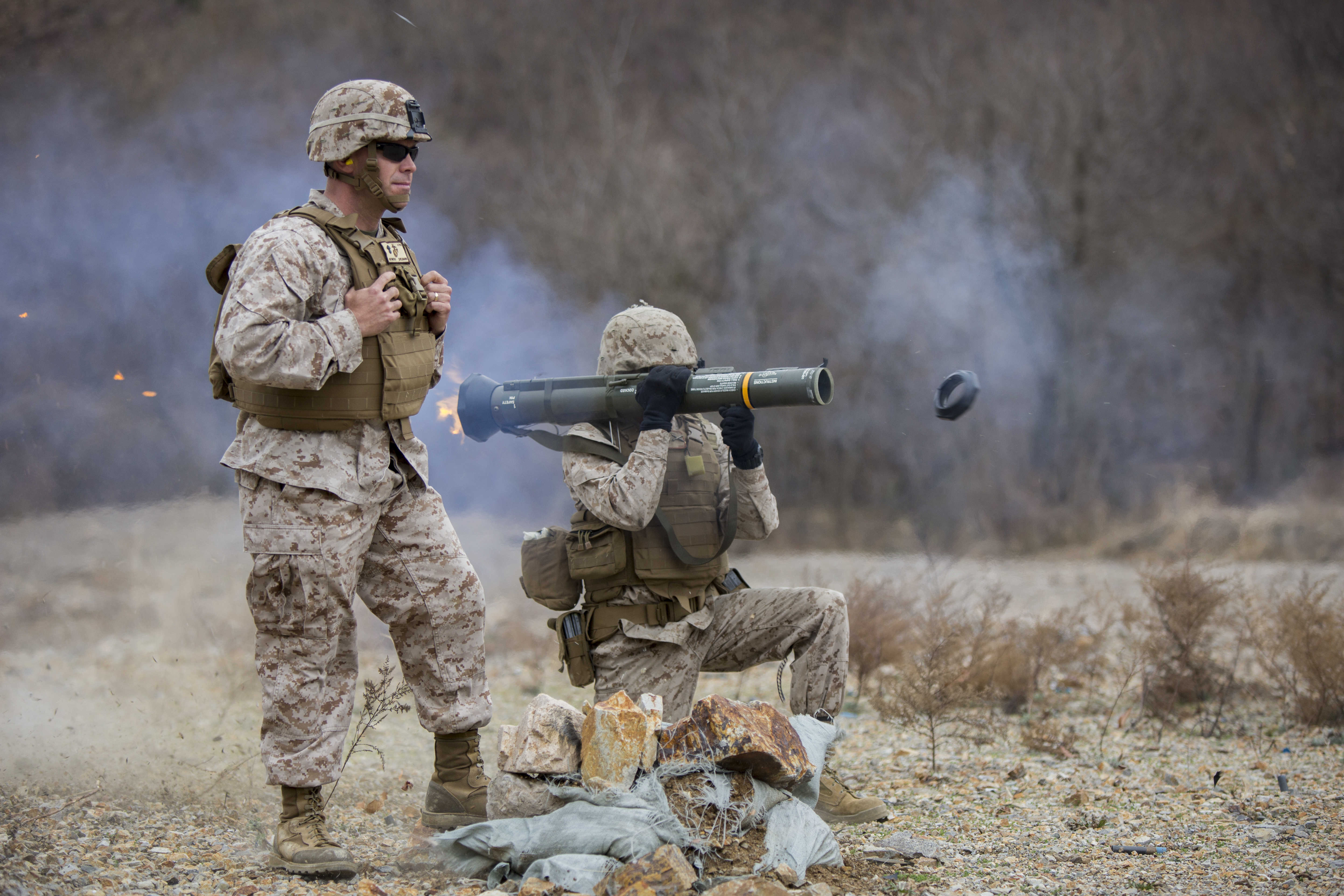U.S. Marine Corps Cpl. Lloyd Burton the III, Field Artillery Cannoneer, with A Battery, 1st Battalion 12th Marines, 3D Marine Division, fires an M136E1 AT4-CS confined space light anti-armor weapon at a live fire training event during Exercise Ssang Yong 14 at Suesongri, South Korea, March 26, 2014. Exercise Ssang Yong 14 is conducted annually in the Republic of Korea (ROK) to enhance interoperablility between U.S. and ROK forces by performing a full spectrum of amphibious operations while showcasing sea-based power projection in the Pacific. (U.S. Marine Corps Photo by Lance Cpl Tyler S. Dietrich/ Released)