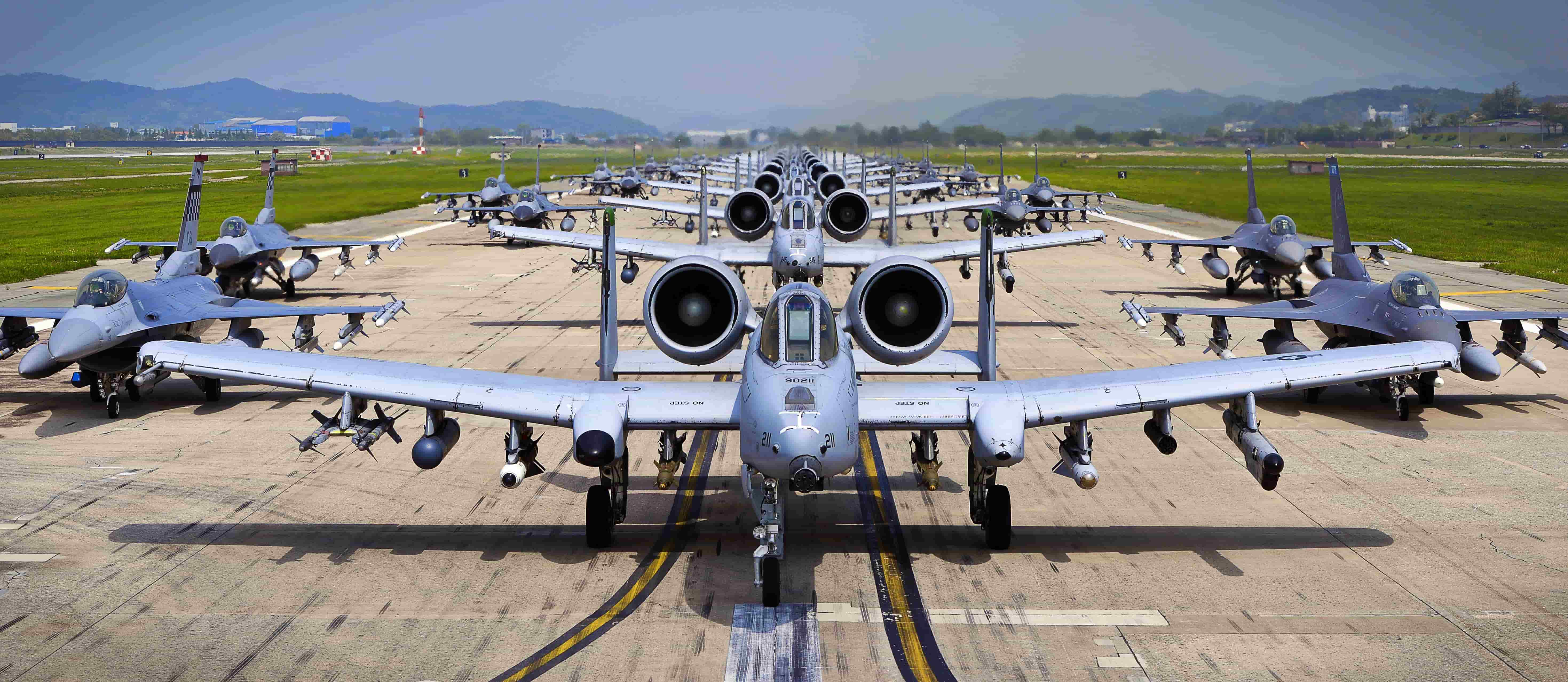 """A-10 Thunderbolt II and F-16 Fighting Falcon fighter aircraft perform an 'Elephant Walk' on the runway this week during Exercise Beverly Herd 16-01 at Osan Air Base, Republic of Korea. The Elephant Walk was a demonstration of U.S. Air Force capabilities and strength and showcases the wing's ability to generate combat airpower in an expedient manner in order to respond to simulated contingency operations. The A-10 Thunderbolt II aircraft are the 25th Fighter Squadron """"Draggins"""" and the F-16 Fighting Falcon aircraft are the 36th Fighter Squadron """"Friends"""" from the 51st Fighter Wing, Osan AB, ROK; the additional F-16 aircraft are the 179th Fighter Squadron """"Bulldogs"""" from the 148th Fighter Wing out of Duluth Air National Guard Base, Minnesota. (U.S. Air Force photo by Tech. Sgt. Travis Edwards/Released)"""