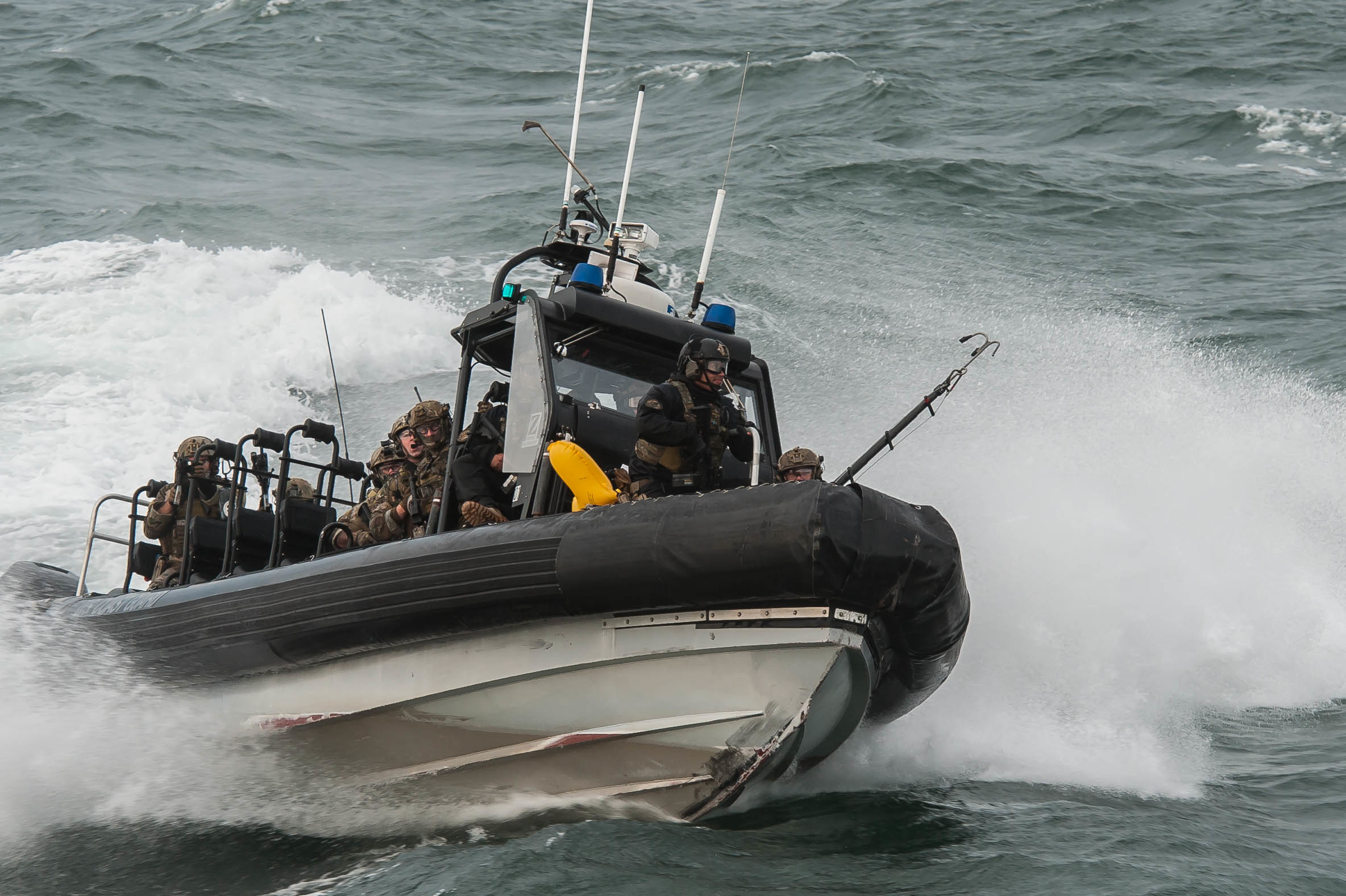 The Coast Guard's Maritime Security Response Team (MSRT) from Virginia participates in a training evolution in Hyannis, Mass., Thursday, Oct., 22, 2015. The highly trained and specialized team, using a real-world underway ferry, practiced tactical boardings-at-sea, active shooter scenarios, and detection of radiological material. (U.S. Coast Guard photo by Petty Officer 3rd Class Ross Ruddell)